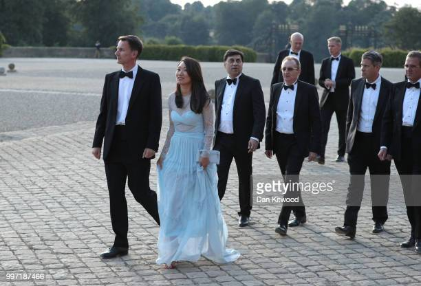 Foreign Secretary Jeremy Hunt with wife Lucia and guests wait for the arrival of US President Donald Trump and First Lady Melania Trump at Blenheim...
