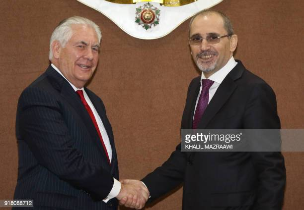 US Foreign Secretary Rex Tillerson shakes hands with Jordanian Foreign Minister Ayman Safadi during their meeting in Amman on February 14 2018...