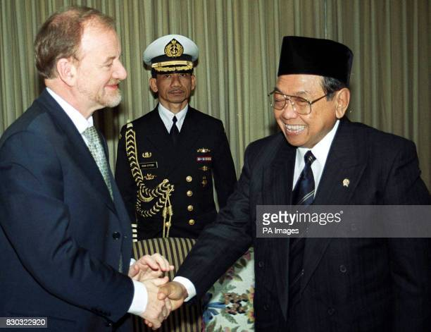 Foreign Secretary Robin Cook greets Indonesian President Abdurrahman Wahid after he arrived in London for a visit expected to centre on trade and aid...