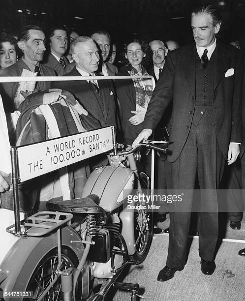 Foreign Secretary Sir Anthony Eden at the Cycle and Motor Show unveiling the 100000th BSA Bantam motorcycle at Earl's Court London November 14th 1953