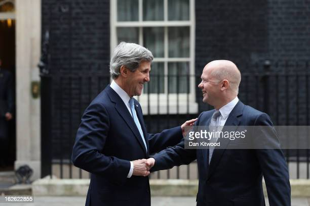 Foreign Secretary William Hague and US Secretary of State John Kerry shake hands as they leave 10 Downing Street on February 25 2013 in London...