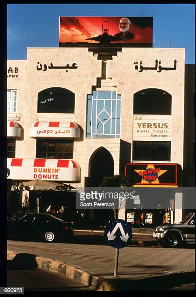 Foreign shops line a street May 17 1998 in Amman Jordan Still a teenager when crowned in 1952 King Hussein has led the young Arab nation through...