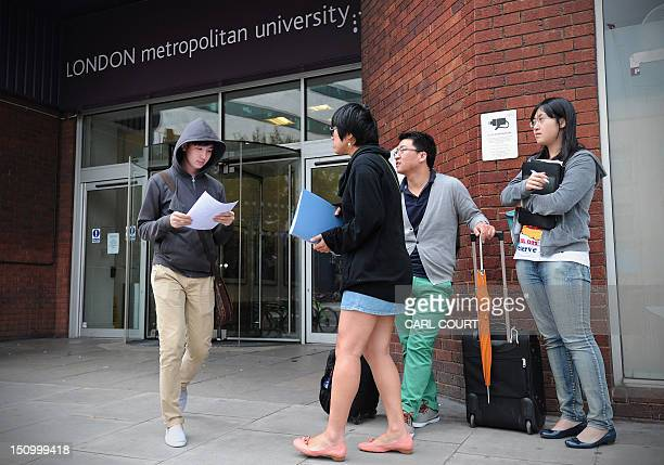 Foreign students and advisors are pictured outside a campus of the London Metropolitan University in London on August 30 2012 Thousands of overseas...
