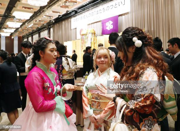 Foreign students chat during their comingofage ceremony in Tokyo on Jan 14 2019 ==Kyodo