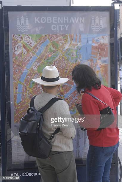 Foreign tourist couple studing Copenahgen City Map 16 June 2011