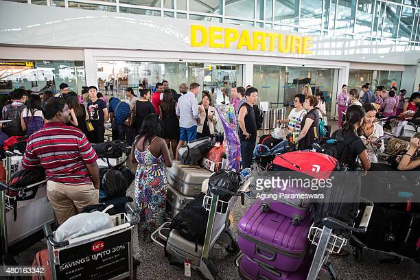 Foreign tourist flock at Ngurah Rai International airport on July 10 2015 in Denpasar Bali Indonesia 277 flights include 160 domestic flight and 117...