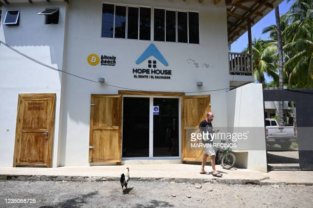 Foreign tourist is seen in front of the Bitcoin Beach headquarters house in El Zonte, La Libertad, El Salvador on September 4, 2021. - The Congress...