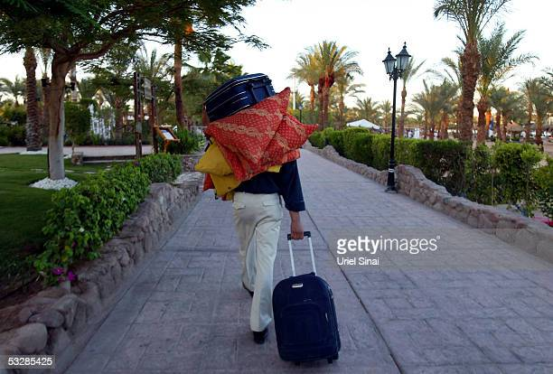 Foreign tourist leaves his hotel on July 25 2005 in the Egyptian Red Sea resort of Sharm elSheikh With foreign tourists cutting short their holidays...