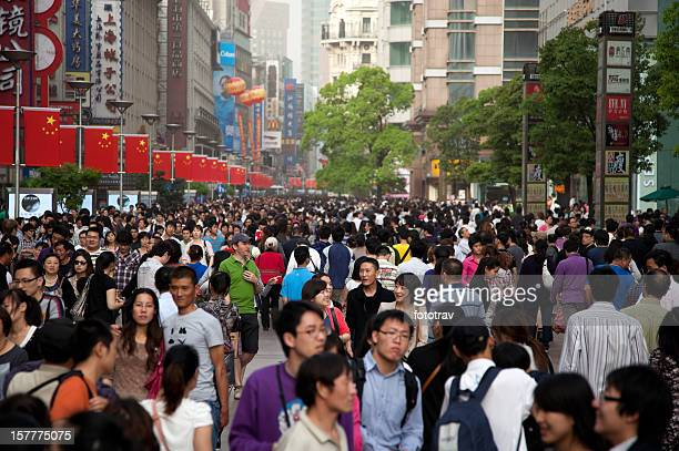 Foreign tourist lost in middle of Chinese crowd, Shanghai, China