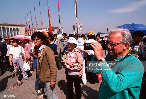 A foreign tourist takes pictures of the prodemocracy movement in Tiananmen Square Prodemocracy demonstrators and protestors filled the square for...