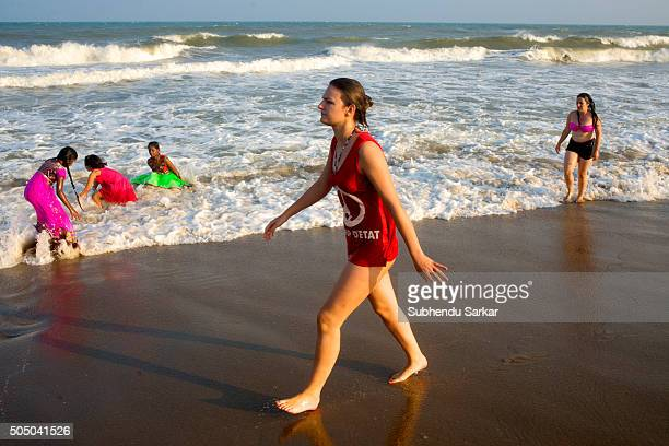 Foreign tourists enjoy themselves bathing in sea in Puducherry Puducherry formerly known as Pondicherry is a Union Territory of India In 1674...