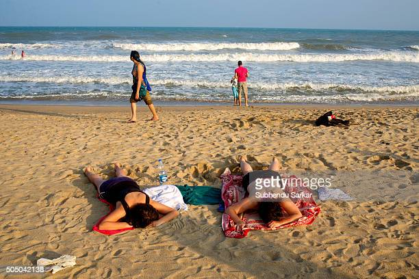 Foreign tourists enjoy themselves by the sea during afternoon is a favourite past time of the people in Puducherry Puducherry formerly known as...