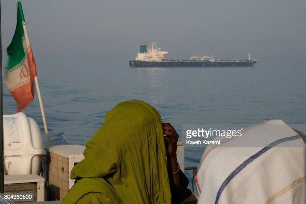 Foreign tourists in veils seen on a passenger boat with the Iranian flag amass in the waters of Strait of Hormuz on May 2 2017 near Hormuz Island...