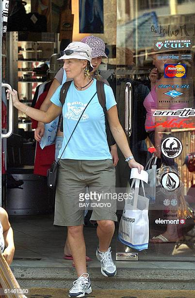 Foreign tourists leave a store in Kuta Bali 11 October 2004 Indonesia on Tuesday marks two years since the bombings that killed 202 people on idyllic...