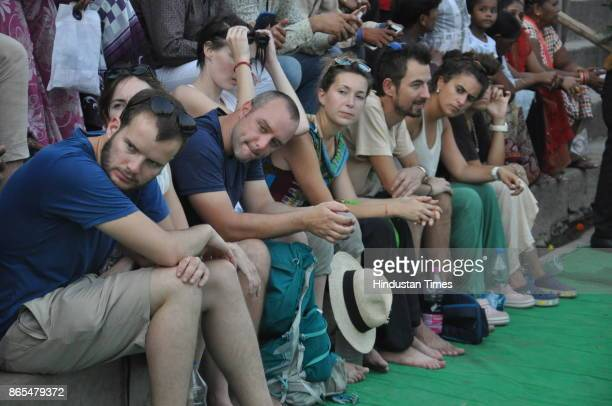 Foreign tourists Nag Nathaiya festival celebrations at Tulsi Ghat on October 23 2017 in Varanasi India Nag Nathaiya festival was first started in the...