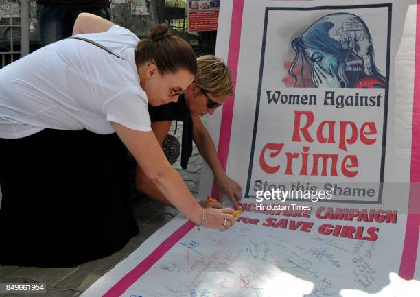 Foreign tourists participate in signature campaign to show their support towards crime against women and child abuse on September 19 2017 in...