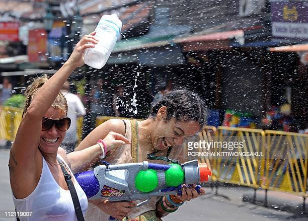 Foreign tourists play with water on Khaosan road during Songkran festival in Bangkok on April 12 2011 Songkran is the Thai New Year which starts on...