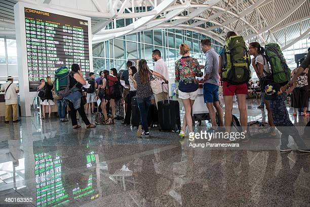 Foreign tourists queue to ask their flight schedule information at Ngurah Rai International airport on July 10 2015 in Denpasar Bali Indonesia 277...