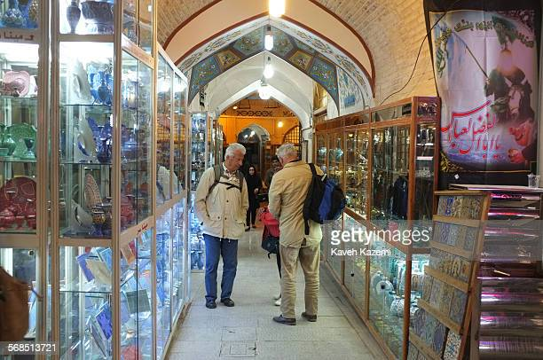 Foreign tourists seen shopping in the main bazaar with local handicrafts on display in shop windows off Naqsh-e Jahan square on October 30th, 2014 in...