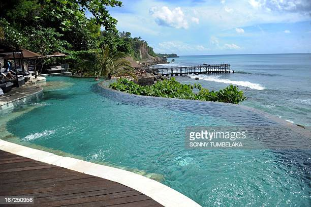 Foreign tourists swim in a pool near the beach in Jimbaran on Indonesia's resort island of Bali on April 23 2013 According to data from the Central...