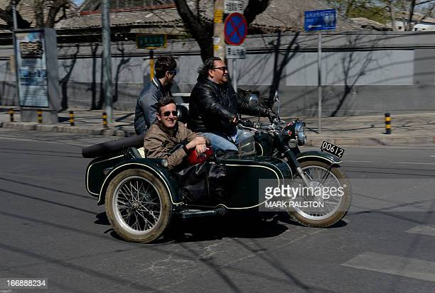 Foreign tourists take a motorcycle tour beside Jingshan Park as Beijing enjoys a pollution free spring day on April 18 2013 The historic 700 year old...