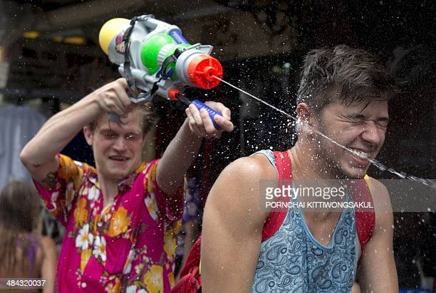Foreign tourists take part in water battles to celebrate Songkran Festival for the Thai New Year at Khao San road in Bangkok on April 12 2014...