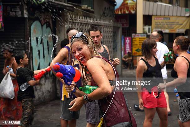 Foreign tourists take part in water battles to celebrate the Songkran Festival for the Thai New Year at Khao San road in Bangkok The Songkran...
