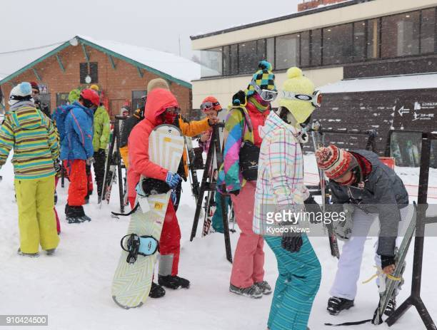 Foreign tourists take to the slopes at the Kusatsu Kokusai Ski Resort near Mt MotoShirane in Gunma Prefecture eastern Japan on Jan 24 a day after the...