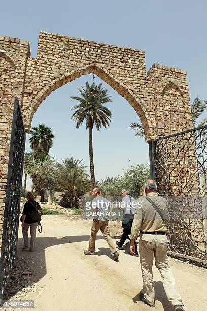 Foreign tourists walk through an archway as they visit the monument of Junayd alBaghdadi a Muslim mystic and historical figure on April 22 in Baghdad...