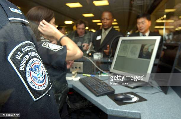 Foreign travelers are screened using the Homeland Security Department's new program called US Visitor and Immigrant Status Indicator Technology at...