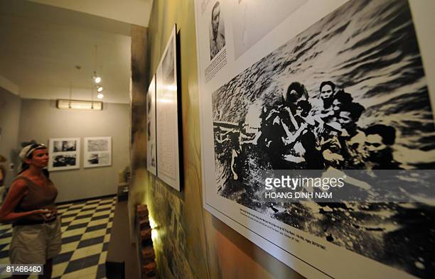 A foreign visitor looks at a photograph showing the current US Republican presidential candidate then US Navy Lieutnantcommander pilot John McCain...