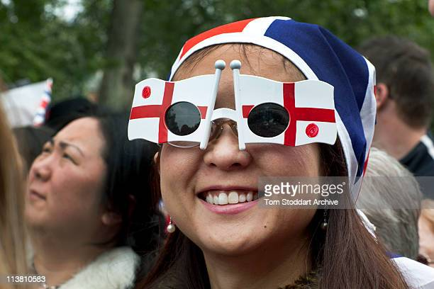 A foreign visitor shows her support for the Royal couple by wearing glasses in the colours of the flag of St George at the wedding of Prince William...
