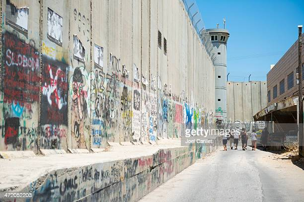 foreign visitors touring separation wall in bethlehem - historical palestine stock pictures, royalty-free photos & images