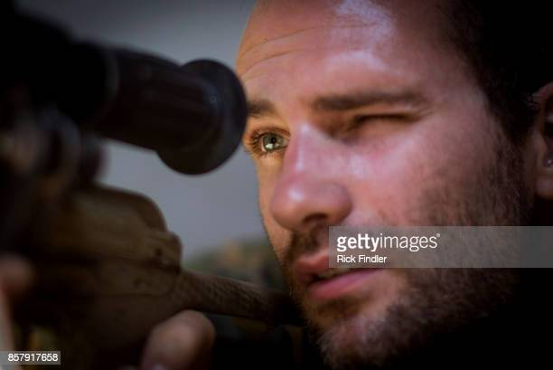 Foreign volunteer fighter 'Macer Gifford' aged 30 and originally from Cambridgeshire in the UK takes up his sniper position in a tower on the front...