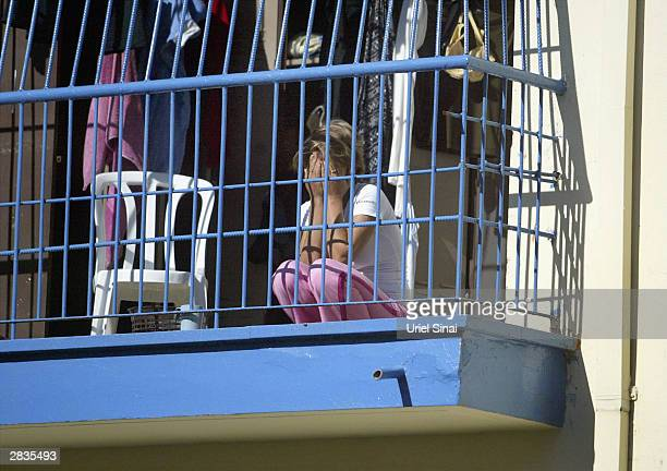 A foreign woman arrested by Israeli police during a raid on a brothel looks out of her barred room where she is held ahead of her deportation in a...