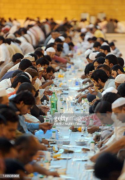 Foreign workers break their fast outside the Imam Turki bin Abdullah mosque in the Saudi capital Riyadh during Islam's holy month of Ramadan on...