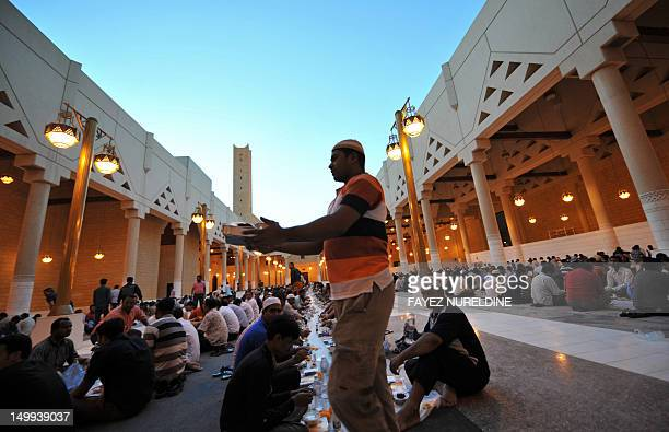 Foreign workers prepare to break their fast outside the Imam Turki bin Abdullah mosque in the Saudi capital Riyadh during Islam's holy month of...