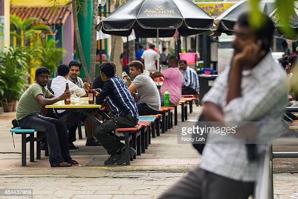 Foreign workers walk around Little India on December 9 2013 in Singapore Hundreds of South Asian workers rioted in Singapore late Sunday after being...