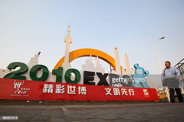 A foreigner passes by the mascot of the 2010 Shanghai World Expo on April 21 2009 in Shanghai China Expo 2010 is a scheduled World Expo in the grand...