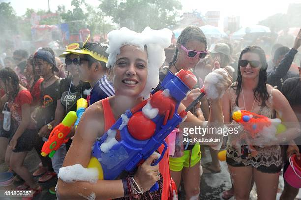 A foreigner poses with her water gun during the Songkran festival at Tapae junction The Songkran festival which is the traditional Thai new year is...