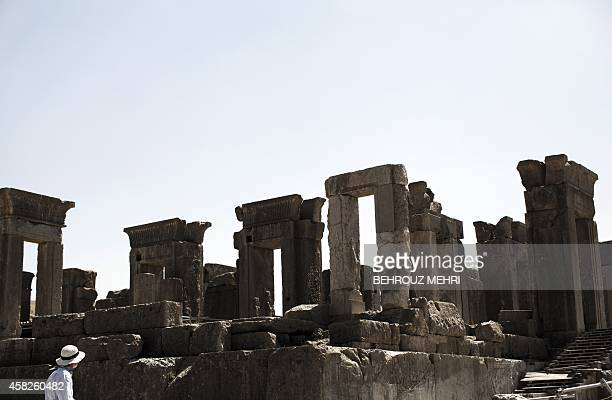Foreigner tourist visits the Tachara Palace also known as the palace of King Darius of Achaemenid at the ancient Persian city of Persepolis near...