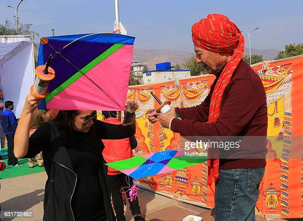 Foreigner tourists enjoy during the Kite Festival on the occasion of Makar Sankranti at Jal Mahal in Jaipur Rajasthan India 14 Jan2017Makar Sankranti...