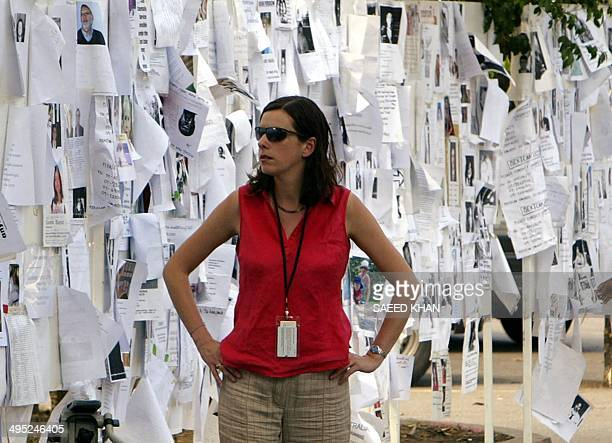 A Foreigner walks past notices of missing person at city hall in Phuket province southern of Thailand after two weeks of tsunami disaster 09 January...