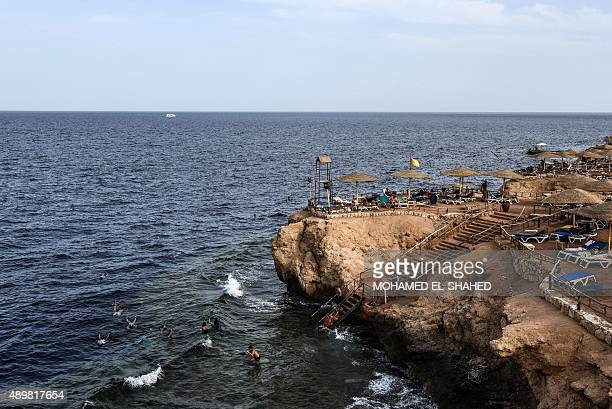 Foreigners bask in the sun off the coast of the Egyptian Red Sea resort of Sharm ElSheikh on the first day of the Muslim Eid alAdha holiday on...