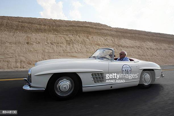 Foreigners drive in a 1957 Mercedes 300 SL Roadster vintage car during a rally tour in the central Jordanian city of Kerak on October 25 2008 25...