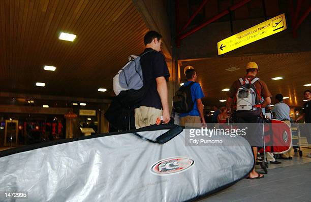 Foreigners wait in line at Ngurah Rai International Airport October 13 2002 in Denpasar Bali Indonesia Foreigners began leaving Bali after a bombing...