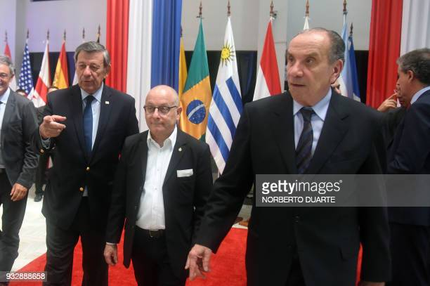 Foreing ministers of Uruguay Rodolfo Nin Novoa Argentina Jorge Faurie and Brazil Alyosio Nunes are pictured at the end of a meeting at the...