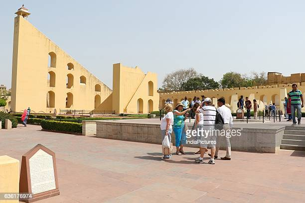 Foreinger tourist pose with indian kids at Historical Jantar Mantar in Jaipur city of Rajasthan India