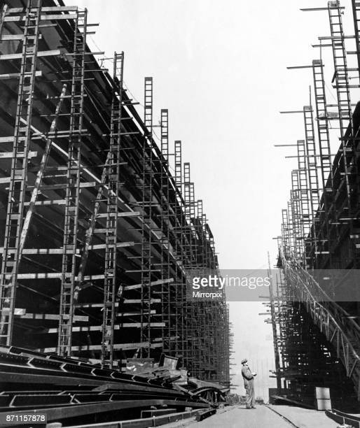 Foreman checks area under construction and area completed on new liners being constructed at Stephen and Sons Ltd shipyard, Glasgow. This was a...