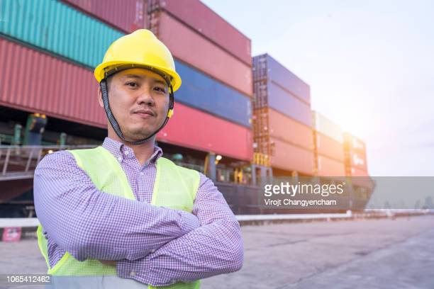 Foreman control loading containers working at Cargo freight ship
